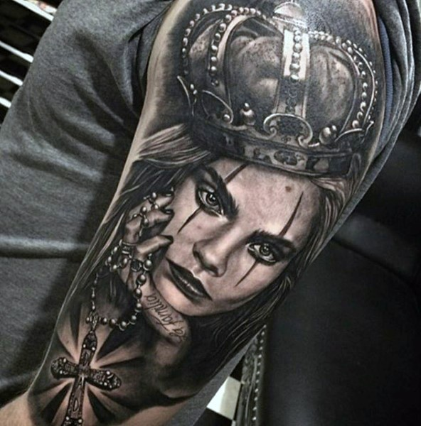 Colored realistic looking shoulder tattoo of woman with crown and cross