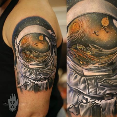 Colored shoulder tattoo of astronaut suit