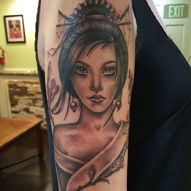 Colored shoulder tattoo of beautiful Asian woman with blooming tree