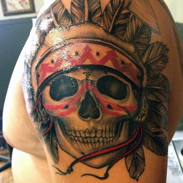 Colored shoulder tattoo of Indian skull with feather