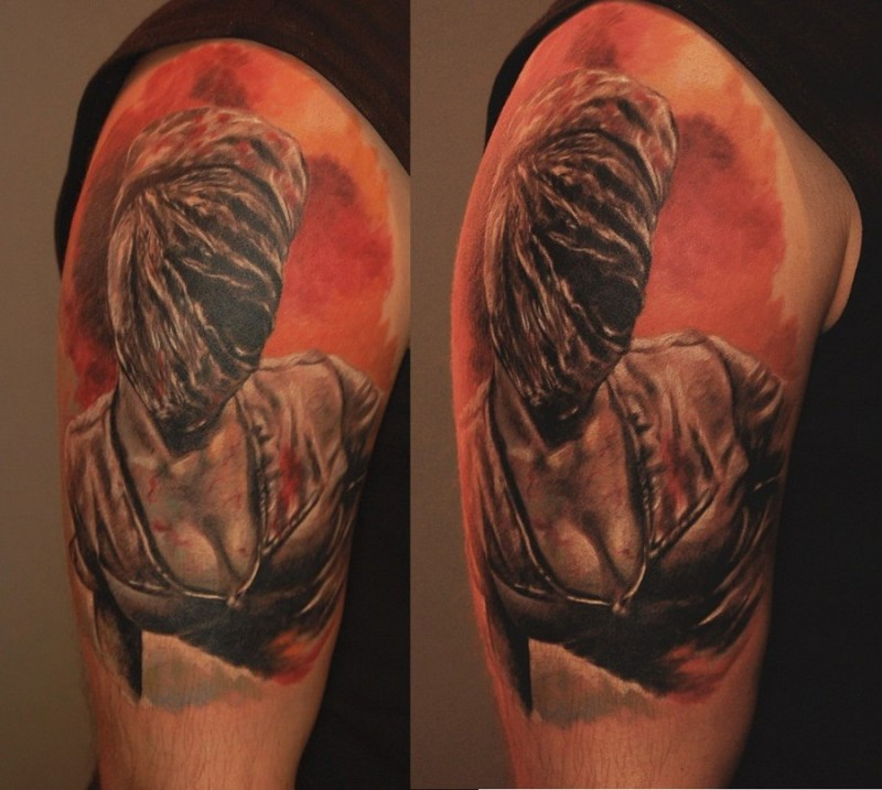 Colored shoulder tattoo of Silent Hill nurse monster