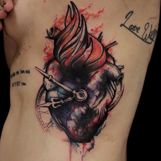 Colored side tattoo of human heart and clock