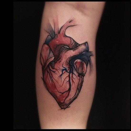Colored simple looking vintage style forearm tattoo of human heart
