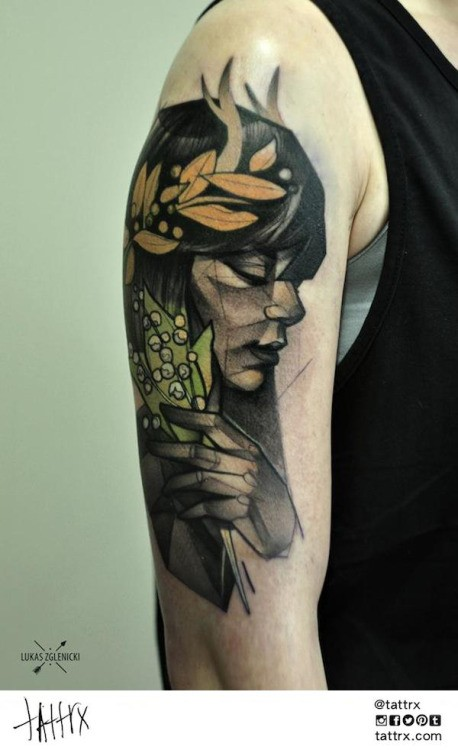 Colored sketch style shoulder tattoo of woman with leaves
