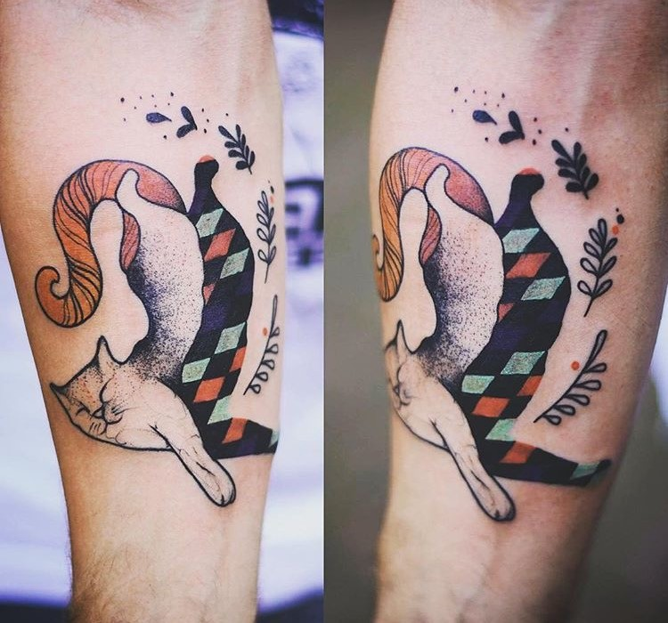 Colored surrealism style forearm tattoo of cat stylized with geometrical figures