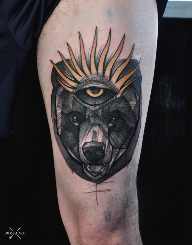 Colored thigh tattoo of fantasy bear with incredible eye