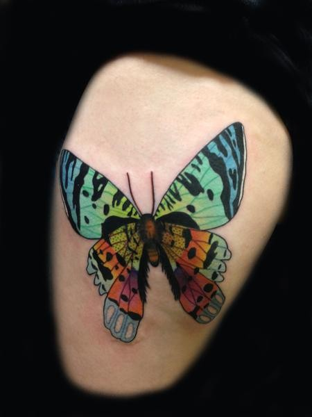 Colored thigh tattoo of natural looking butterfly