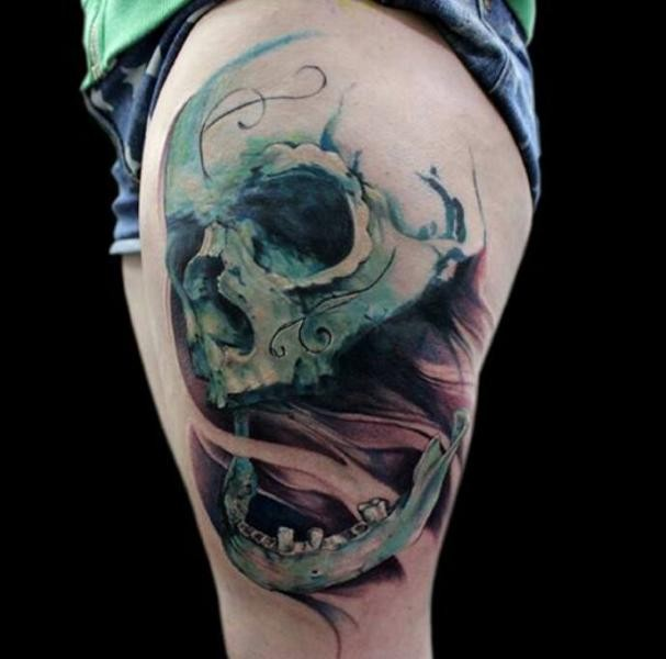 Colored thigh tattoo of skeleton with fog