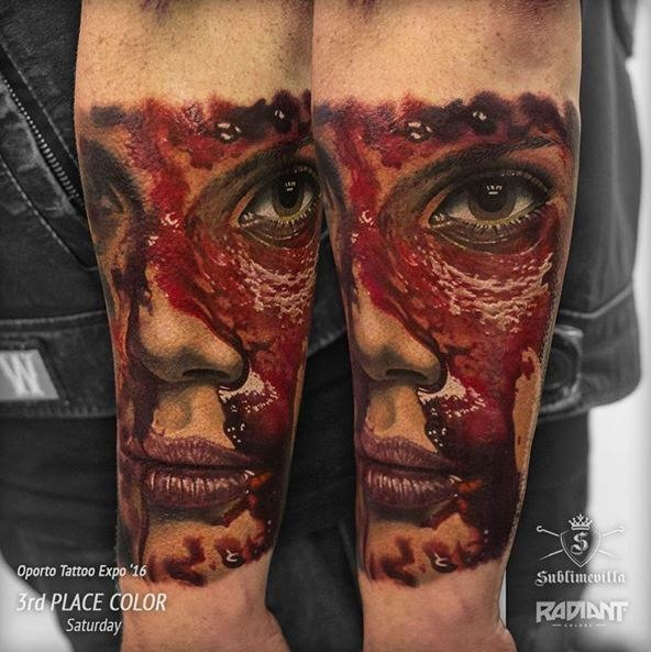 Colored very detailed arm tattoo of bloody woman face