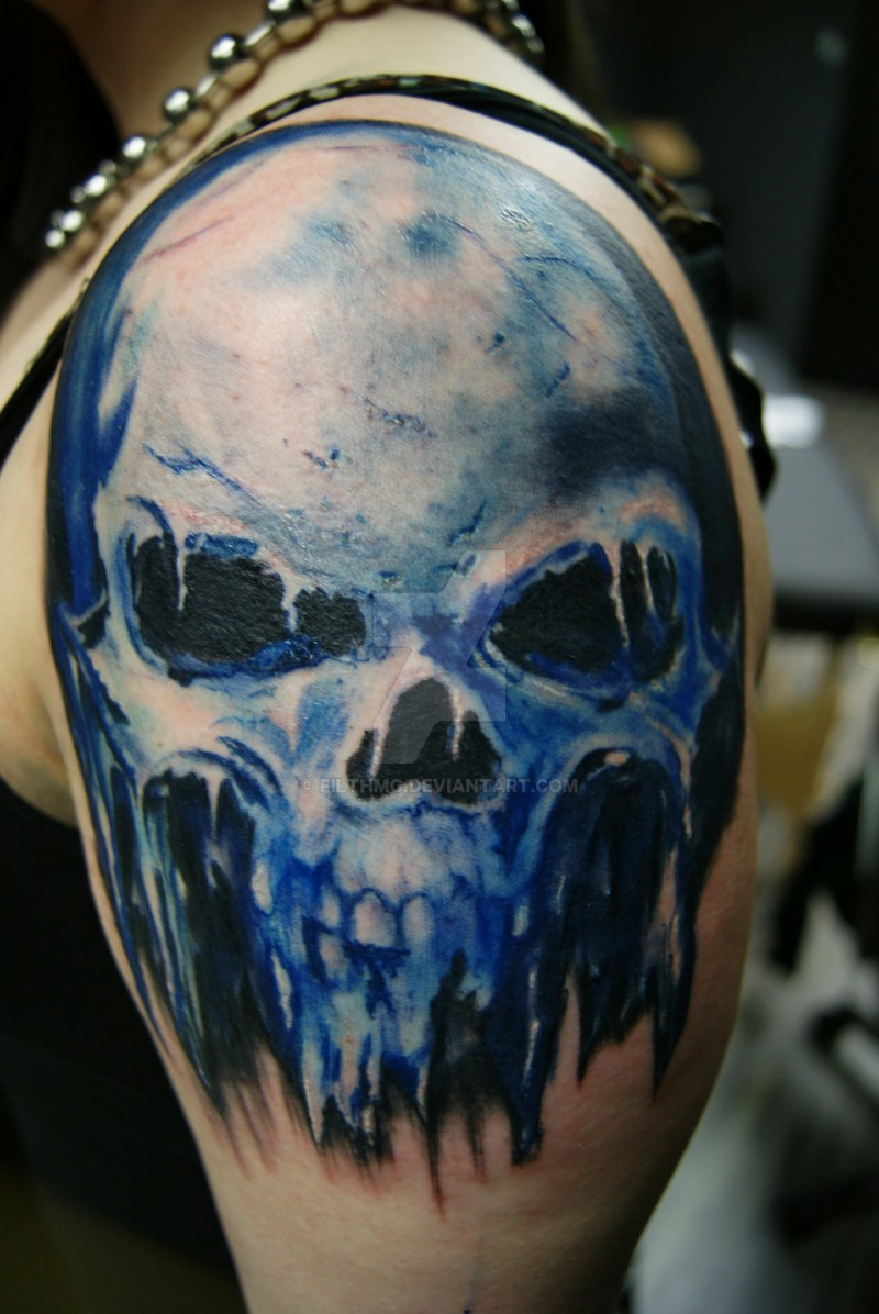 Colorful amazing looking shoulder tattoo of demonic skull