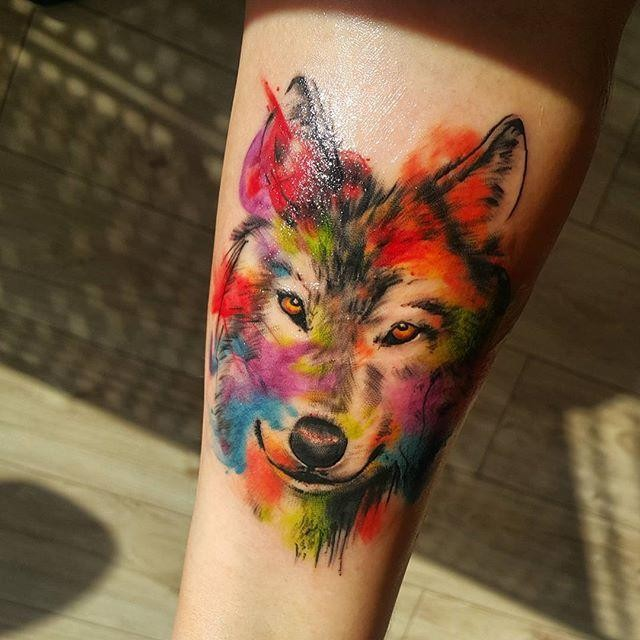 Colorful beautiful looking tattoo of cute wolf portrait