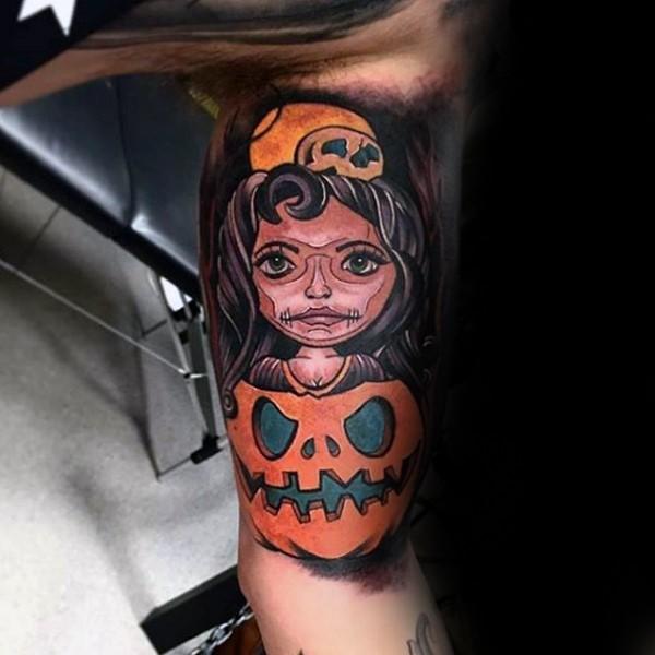 Colorful biceps tattoo of woman inside pumpkin