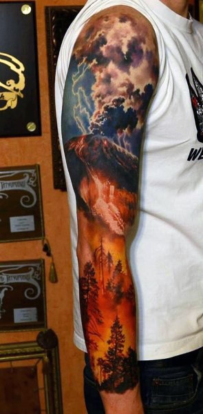 Colorful big flaming volcano with forest tattoo on sleeve