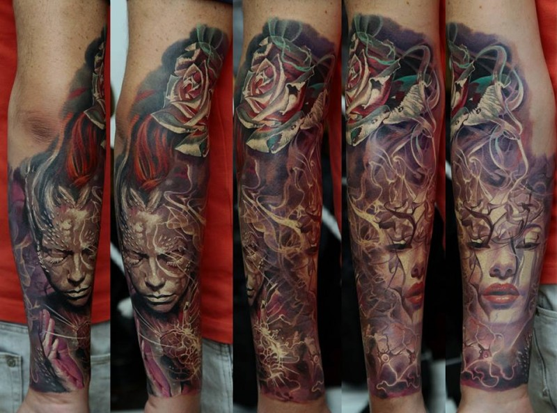 Colorful big forearm tattoo of various tribes people portraits and rose