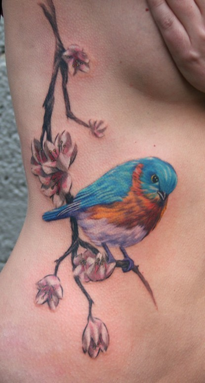 Colorful bird tattoo on its side