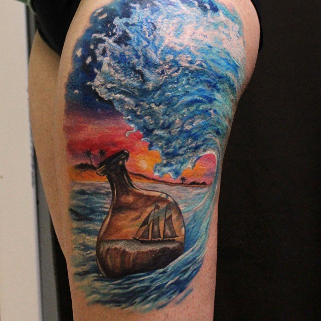 Colorful bottle with a ship in ocean tattoo on thigh