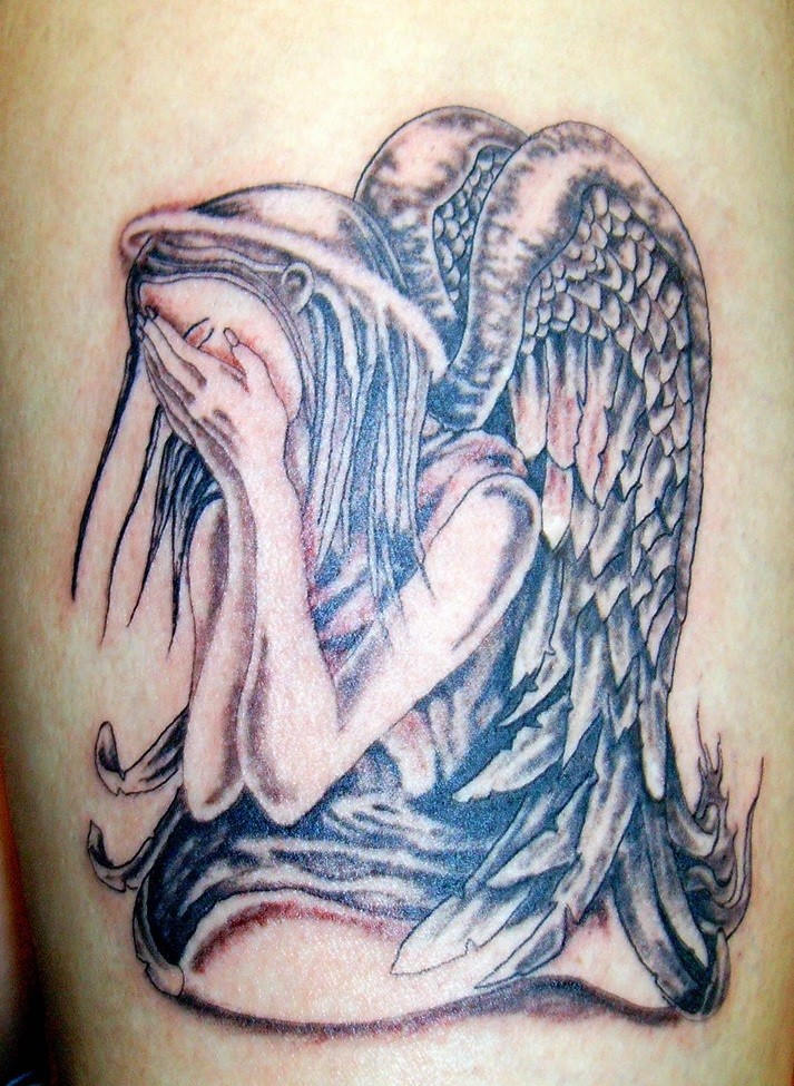 Colorful crying angel tattoo