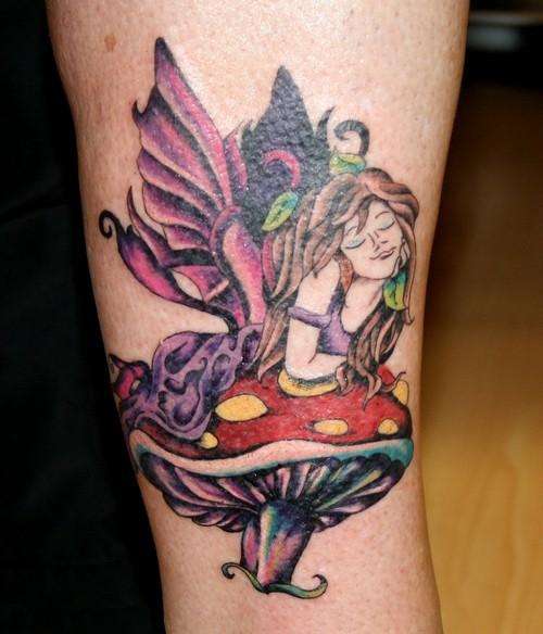 Colorful fairy lying on mushroom tattoo