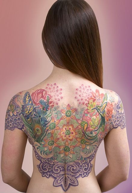 Colorful floral motifs with butterflies and birds tattoo on back