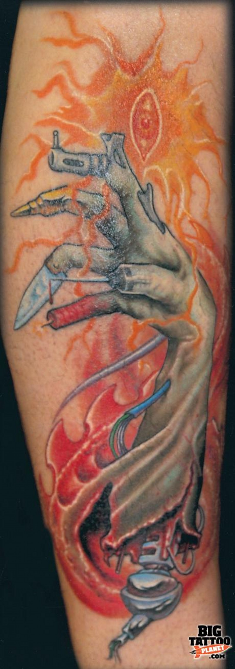 Colorful forearm tattoo of creepy biomechanical arm hand tattoo