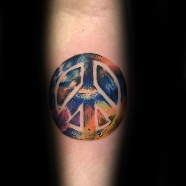 Colorful forearm tattoo of pacific symbol with space