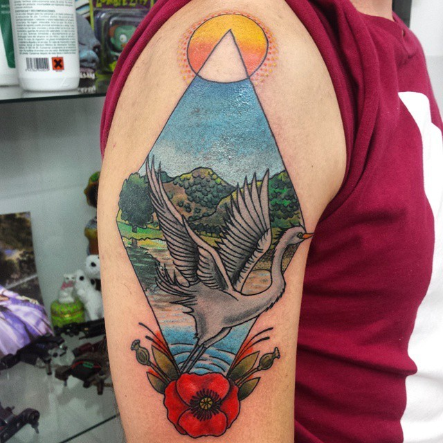 Colorful geometrical shaped tattoo on shoulder with swan and flower