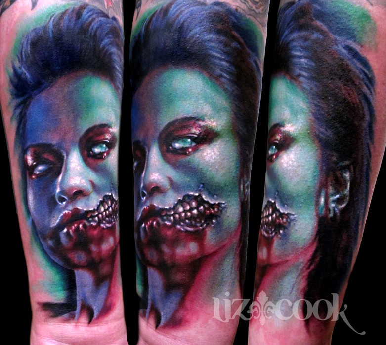 Colorful large creepy looking forearm tattoo of monster woman face