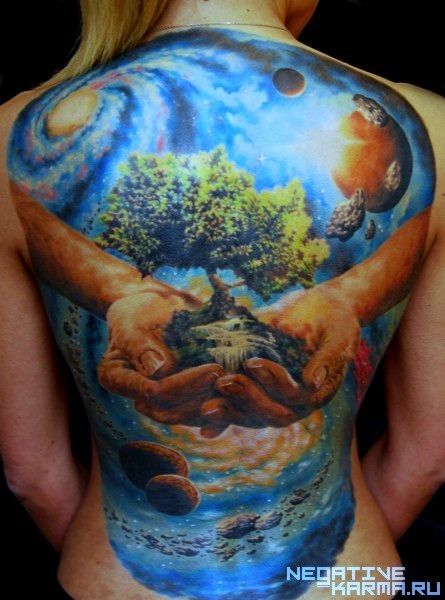 Colorful large whole back tattoo of human hands with tree and planets