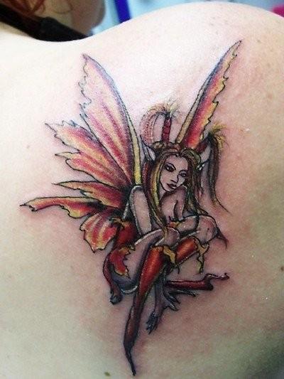 Colorful little fairy tattoo