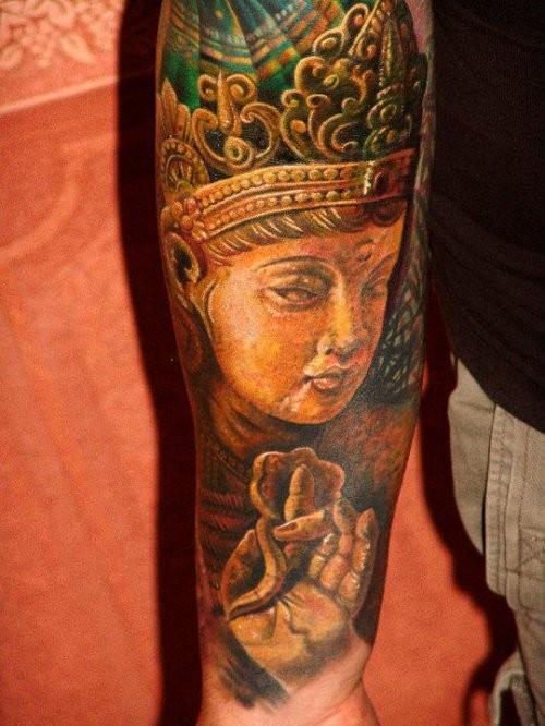 Colorful meditating buddha forearm tattoo