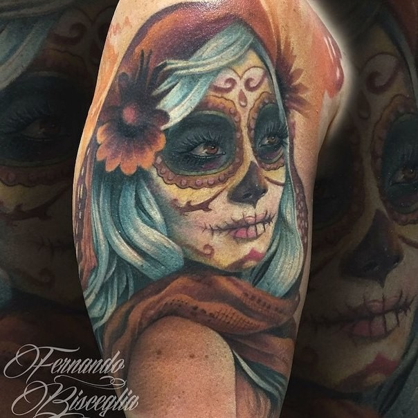 Colorful Mexican traditional shoulder tattoo of woman face with flower in hair