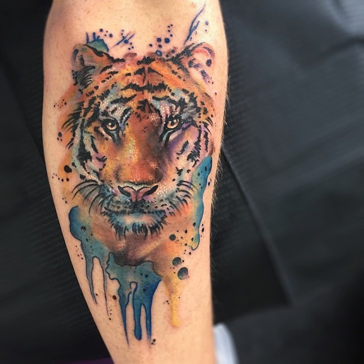 Colorful nice painted watercolor style tattoo of tiger head