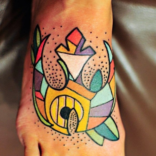 Colorful old style big on foot tattoo of Rebel Alliance symbol