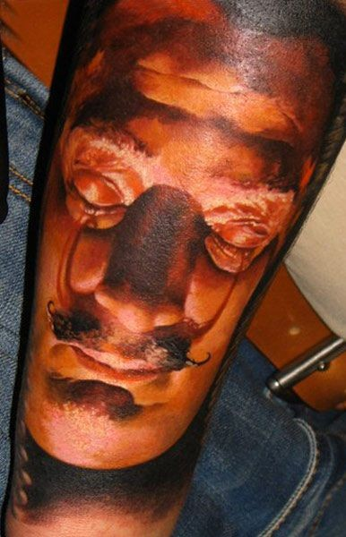 Colorful portrait of Dali forearm tattoo by denis sivak