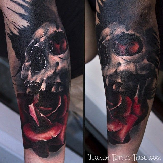 Colorful realistic looking forearm tattoo of human skull with rose