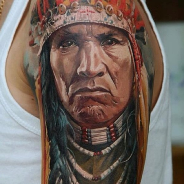 Colorful realistic native american warrior tattoo by Dmitriy Samohin