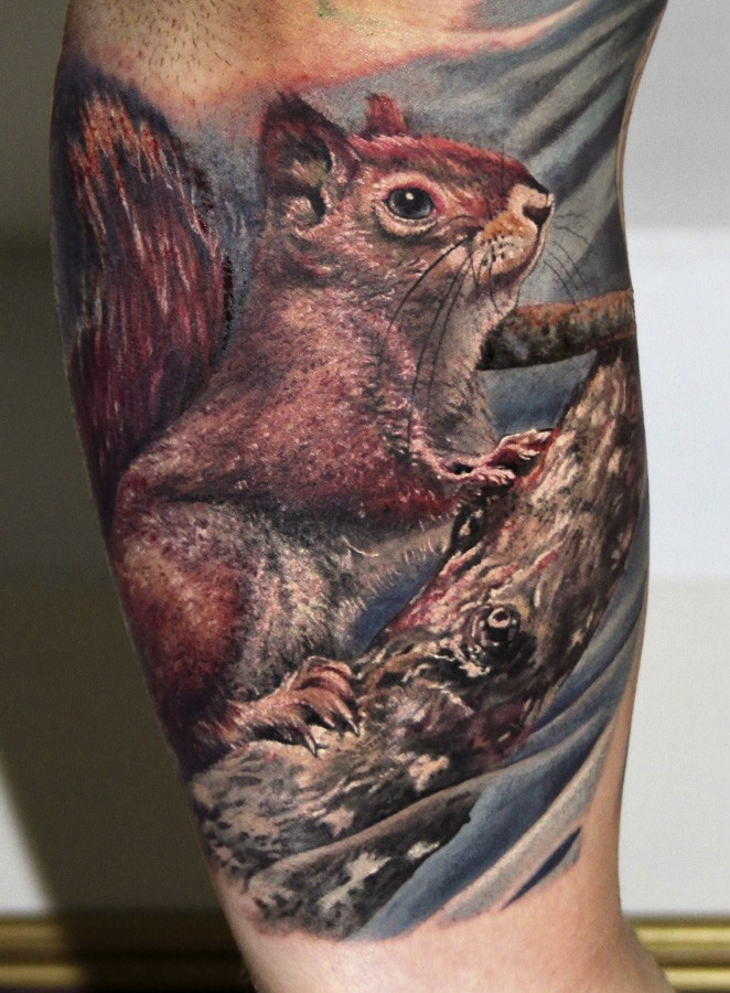 Colorful realistic squirrel tattoo