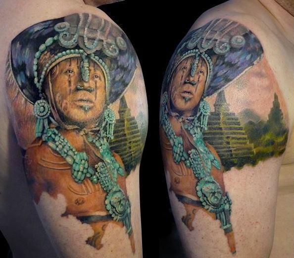 Colorful sacrificer Aztecs people tattoo on shoulder