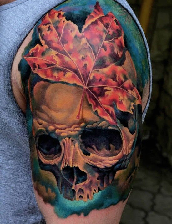 Colorful skull and a maple leaf tattoo on half sleeve