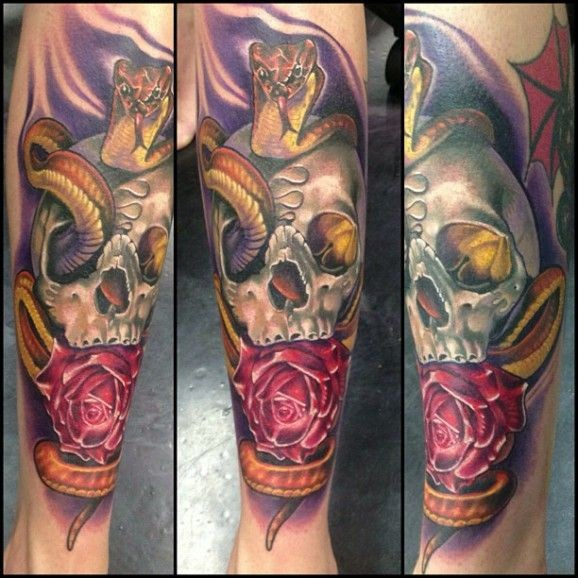 Colorful skull with shake and red rose tattoo by Fabian de Gaillande