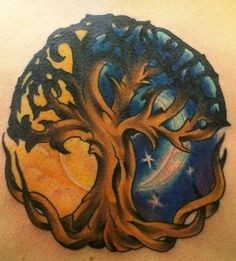 Colorful sun with moon and tree tattoo