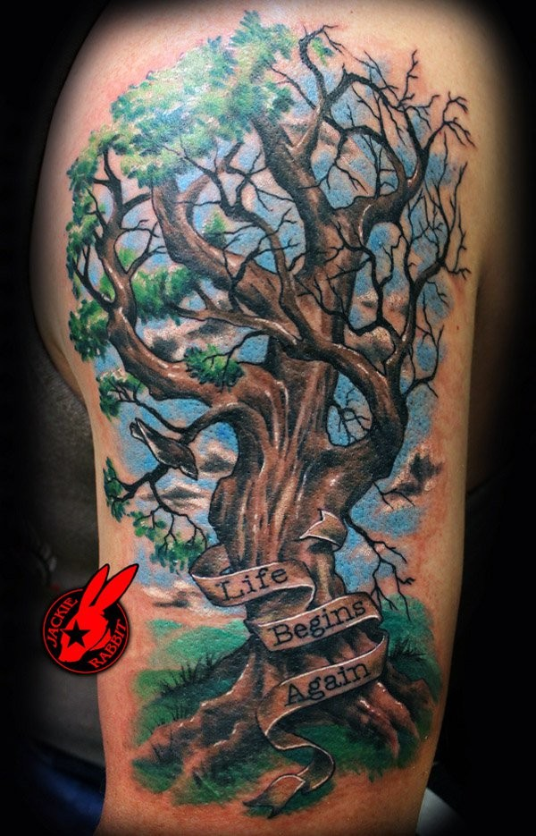 Colorful tree and inscription tattoo