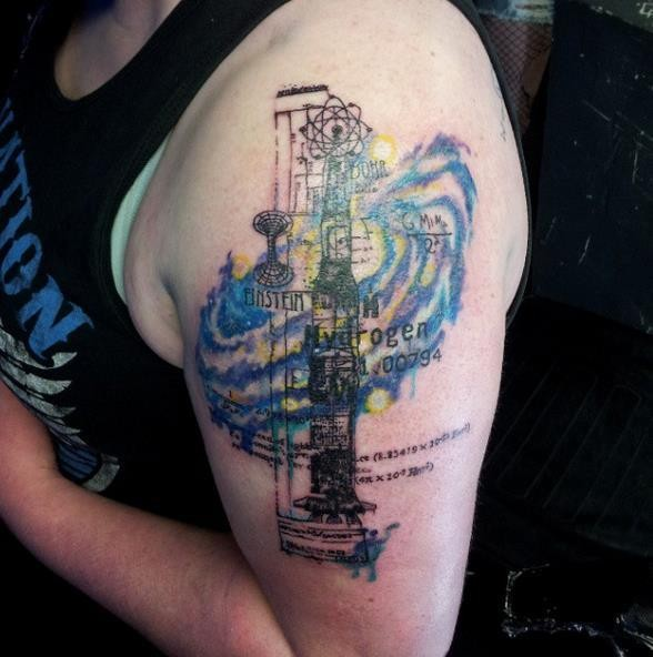Colorful upper arm tattoo of chemistry station with lettering