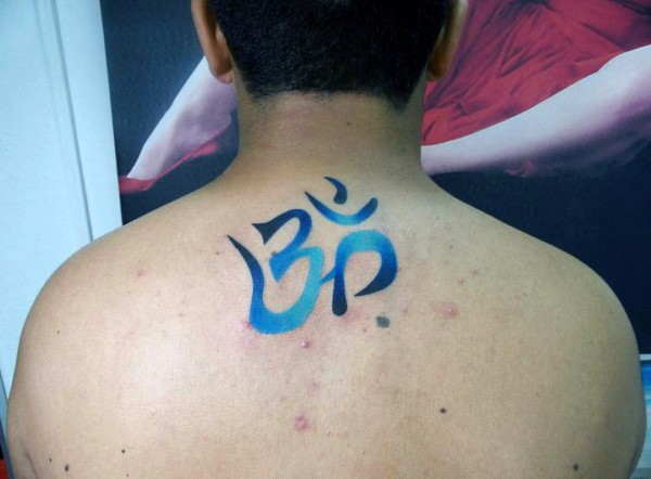 Colorful upper back medium size tattoo of Asian symbol
