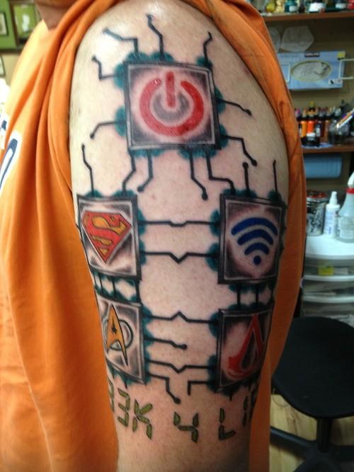 Colorured geek tattoo on half sleeve