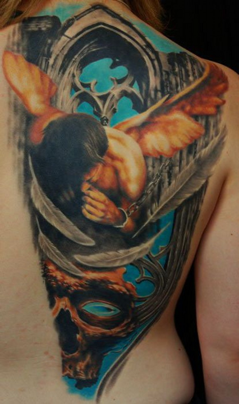 Coloured angel in chains and skull tattoo on back
