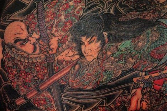 Coloured battle of samurai tattoo