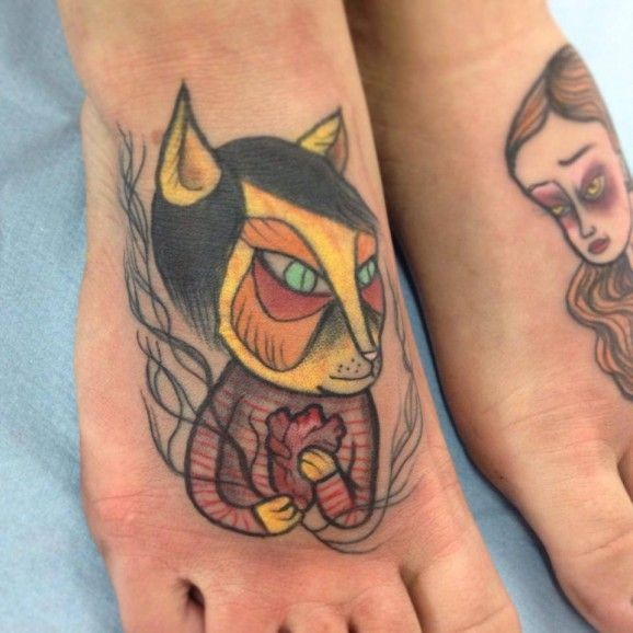 Coloured cat with heart tattoo on feet by Nicoz Balboa