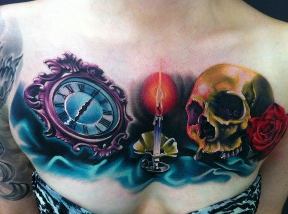 Coloured clock and burning candle with skull tattoo on chest by Fabian de Gaillande