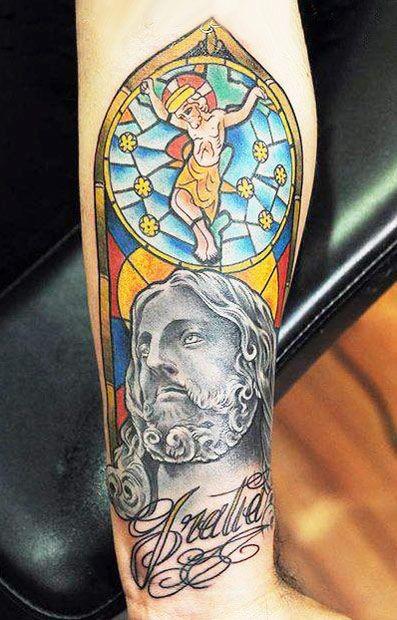 Coloured crucifixion of jesus forearm tattoo